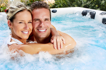 Happy couple in jacuzzi.
