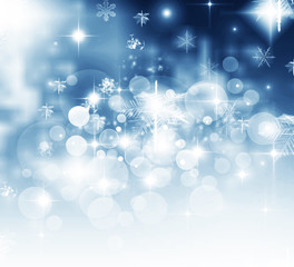 Light abstract Christmas background with white snowflakes