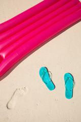 green flip-flops meet red air mattress