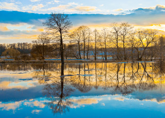 Evening dawn over spring flood of the river