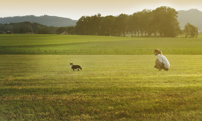 Young woman with cat playing. Outdoor