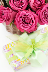 Bouquet of beautiful roses and gift box