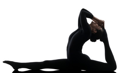 Wall Mural - woman contortionist  exercising gymnastic yoga   silhouette