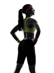 Wall Mural - woman exercising fitness workout  standing silhouette rear view