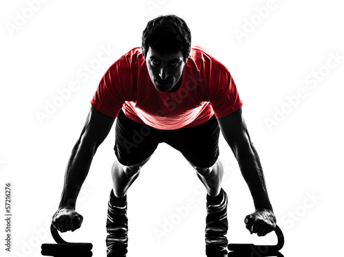Wall mural man exercising fitness workout push ups  silhouette