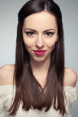Portrait of a beautiful young long-haired brunette smiling