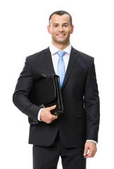 Half-length portrait of businessman keeping suitcase
