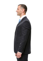 Profile of business man wearing black suit and blue tie
