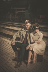Retro couple on a train station