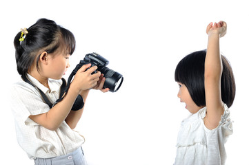 asian little siblings child taking photograph of each other with