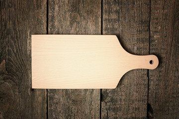 Obraz Pusta deska do krojenia na starym drewnianym tle. - fototapety do salonu