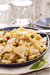 Baked cauliflower with capers and raisins