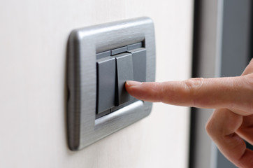 Finger pressing light switch