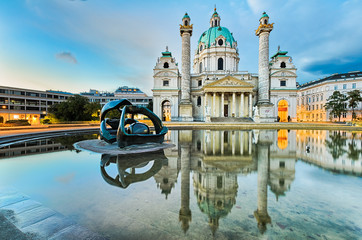 Spoed Fotobehang Wenen Karlskirche in Vienna, Austria at sunrise