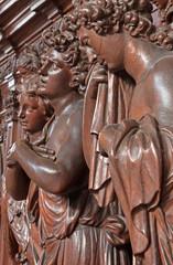 Antwerp - Carved cried angel in St. Charles Borromeo church