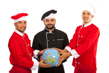 Chefs team holding world globe