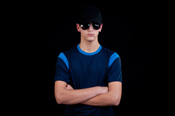 handsome young man with cap and sunglasses