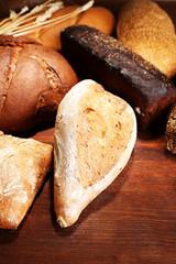 Much bread on wooden board