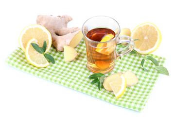 Cup of tea with ginger on napkin isolated on white
