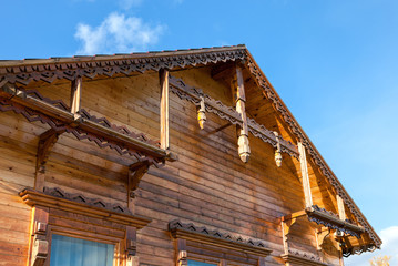 Detail of wooden roof gable on blue sky