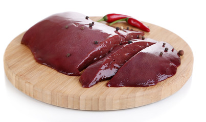 Raw liver on wooden board isolated on white