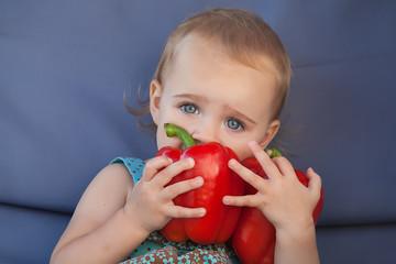 Little Girl Eating Organic Paprika