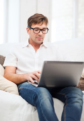 man working with laptop at home