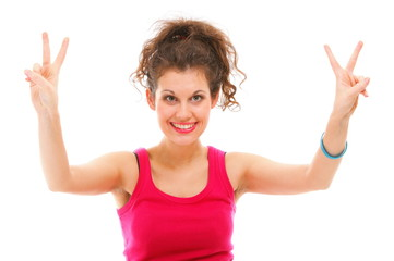 sporty fit happy woman giving victory sign