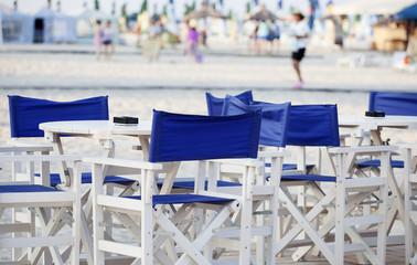 blue chairs on beach