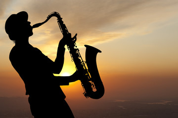 Saxophonist at sunset