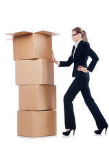 Businesswoman with boxes isolated on white