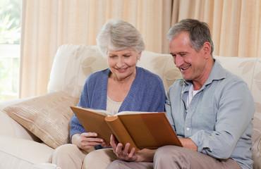 Seniors looking at their photo album