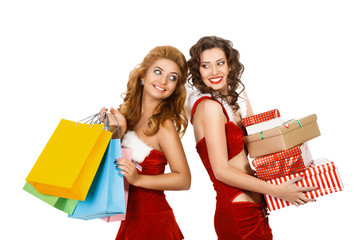 Smiling christmas women holding gift and colorful packages