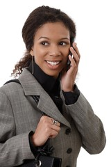 Portrait of attractive businesswoman on phone