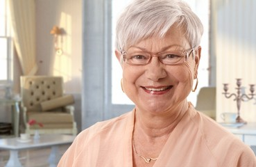 White haired senior woman at home