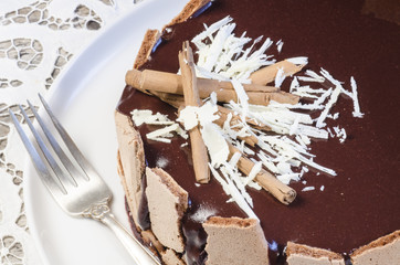 Wall Mural - French chocolate cake covered with mirror chocolate icing. Macro