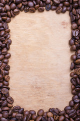 Coffee beans frame on a wooden background