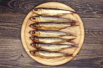Smoked fish on a cutting board