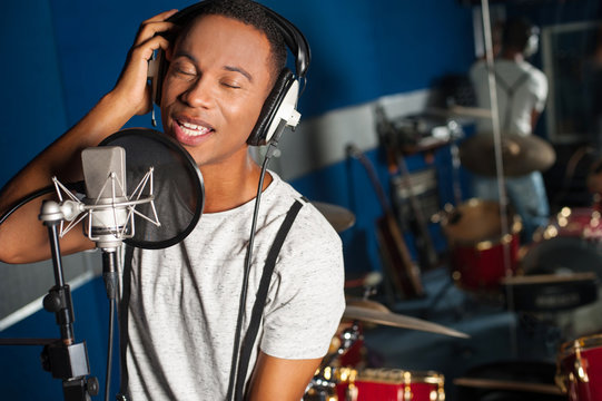 Singer recording a track in studio