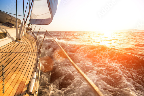 Wall mural Sailing yacht against sunset. Luxury yachts.