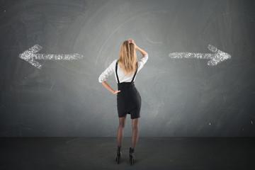 businesswoman must choose between different destinations