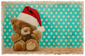 cute vintage teddy bear with santa hat. christmas
