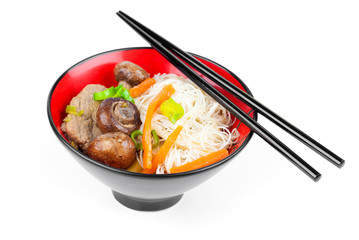 Chinese noodles with beef and vegetables, oriental cuisine