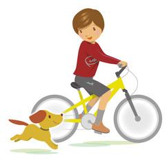 自転車に乗って走る子供と犬