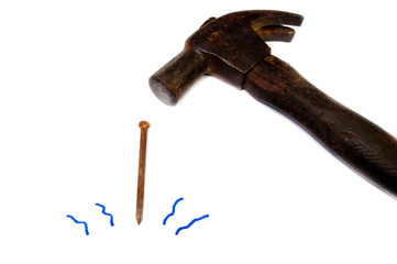 Hammer and nail with white background