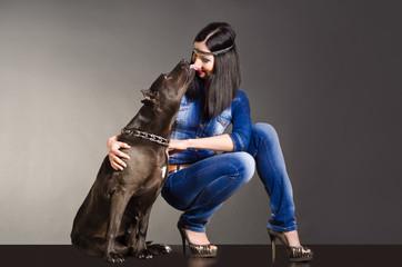 Dog kissing a beautiful  girl