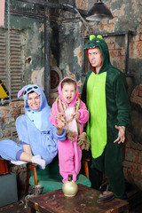Foto op Aluminium Imagination Father, mother and little daughter in costumes of dragons