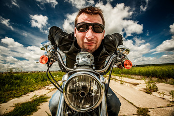 Fototapete - Funny Biker racing on the road
