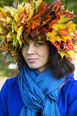 Woman with leaves on head with scarf