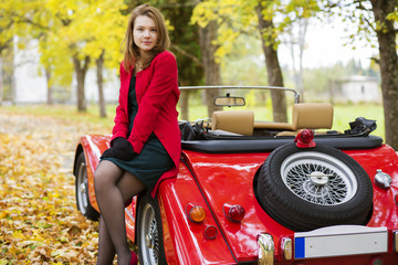 Woman in red and car at park